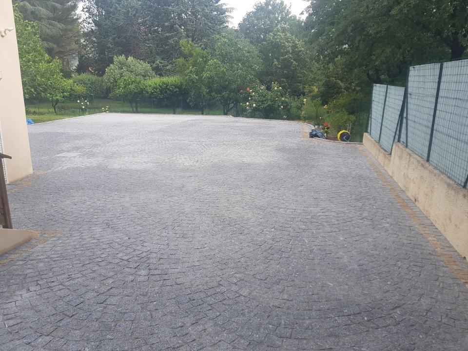 Dacosta pavage granit gris pose en arche terrasse